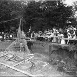View of construction and cornerstone ceremony for Illini Hall circa 1907.