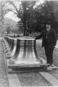 Former University of Illinois President Edmund James poses with the Altgeld Chimes before they were installed in 1920.